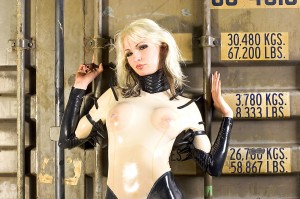 blonde latex with pierced nipples 300x199 Blonde Latex With Pierced Nipples