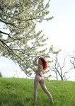 green field red head 7 106x150 hot red head nude in a field with flowers