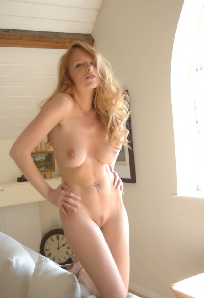 Big natural tit strawberry blonde gets naked and fingers her pussy