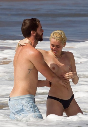 Miley Cyrus – Topless in Hawaii 26 348x500 Miley Cyrus – Hawaii