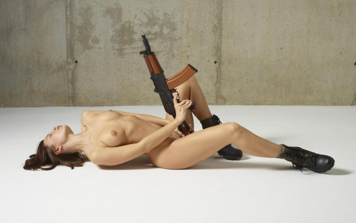 Nude woman with AK 47 700x438 Nude woman with AK 47