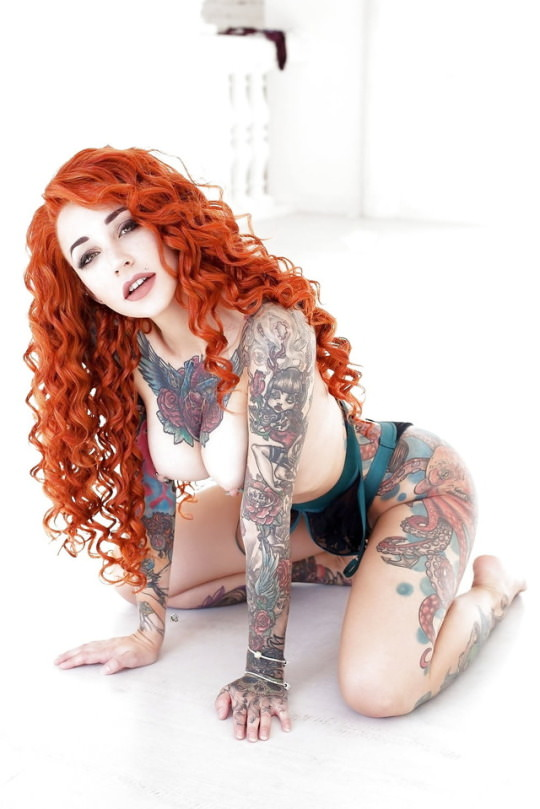 red head with big tattoos.jpg