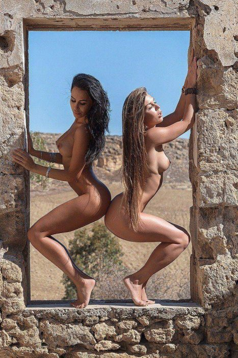 two nude women in an exterior window 467x700 two nude women in an exterior window